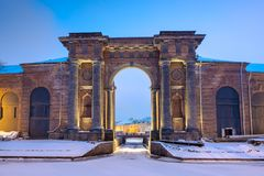 Russia. Arch of the brick building of New Holland in St. Petersburg on the bank of the Moika River on a winter evening. Arch of the brick building of New Holland royalty free stock photography