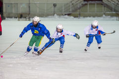 RUSSIA, ARKHANGELSK - DECEMBER 14, 2014: 1-st stage children's hockey League bandy, Russia Royalty Free Stock Photo