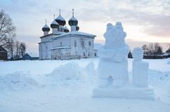 Russia, Arkhangelsk region. Kargopol, Ice sculpture of Masha and bear in front of Annunciation Blagoveschenskaya church in the w. Russia. Arkhangelsk region royalty free stock photo