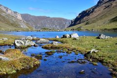 Russia, Arkhyz. Lake Zaprudnoye in autumn in sunnny day.  royalty free stock images
