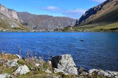 Russia, Arkhyz. Lake Zaprudnoye in autumn in sunnny day.  stock image
