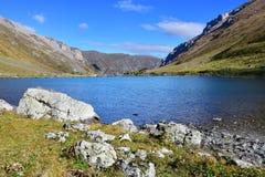 Russia, Arkhyz. Lake Zaprudnoye in autumn in sunnny day.  royalty free stock photo