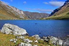 Russia, Arkhyz. Lake Zaprudnoye in autumn in sunnny day.  royalty free stock image
