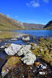 Russia, Arkhyz. Lake Zaprudnoye in autumn in sunnny day.  stock photography