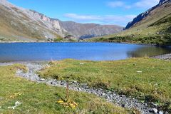 Russia, Arkhyz. Lake Zaprudnoye in autumn in sunnny day. Russia. Arkhyz. Lake Zaprudnoye in autumn in sunnny day stock photography