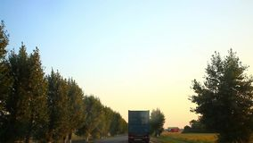 Russia, 15 august 2014, Car on Country Road with. Car on Country Road with Trees stock video footage
