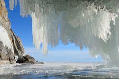 Russia, Baikal lake. Maloe Sea. Icicles  in the grotto on Olkhon island near Uzury village. Russia, Baikal lake.  Icicles  in the grotto on Olkhon island near Stock Photography
