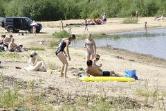 Russia - Berezniki on 18 July : closed of people on the beach stock image