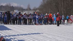 Russia, Berezniki 11 March 2018: male skier start of the race during the continental ski race in the city category-event at the al. L-Russian exhibition center stock footage