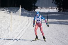 Russia Berezniki March 11, 2018: a young skier during the race, the forest in the classic style in the championship in skiing . Russia Berezniki March 11, 2018 Stock Image