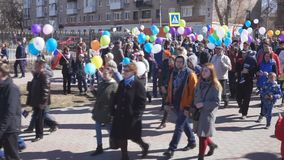 Russia Berezniki may 1, 2018: joyful people walking on the square with balls in their hands.  stock footage