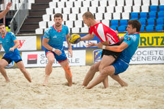 Russia blue vs Belarus red. MOSCOW, RUSSIA - JULY 22-23, 2017: Rugby players in action at the  on European Beach Fives Rugby Championship 2017 in the match Royalty Free Stock Photos