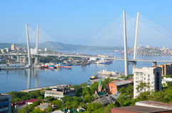 Russia, the bridge across the Golden horn bay in Vladivostok in sunny day. Russia, the bridge across the Golden horn bay in Vladivostok royalty free stock photography