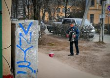 Russia, Bryansk, April 15, 2018. An elderly man plays the accordion on the street to make money. royalty free stock photo