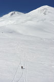 Russia. Caucasus. Elbrus ski resort. Russia. Caucasus. Kabardino-Balkaria. Elbrus ski resort. Winter mountain scenery. Elbrus Mount. Free-ride. Skiers descending Royalty Free Stock Photo