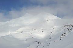 Russia. Caucasus. Elbrus ski resort. Russia. Caucasus. Kabardino-Balkaria. Elbrus ski resort. Winter mountain scenery. Elbrus Mount. Deep blue sky and white Royalty Free Stock Image