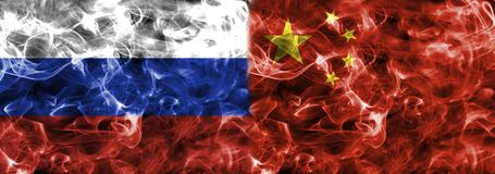Russia and China smoke flag. Isolated on a black background Royalty Free Stock Photo