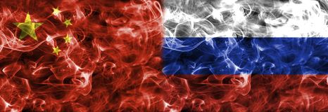 Russia and China smoke flag. Isolated on a black background Stock Photos