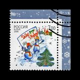 Snowman group with envelope to Father Frost aka Santa Claus, snowflake for Christmas, Russia, circa 2006, royalty free stock image