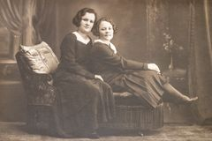 RUSSIA - CIRCA 1920s: Shot of two young women in studio, Vintage Carte de Viste Edwardian era photo.  stock photo