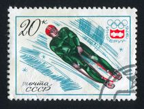 Luge. RUSSIA - CIRCA 1976: stamp printed by Russia, shows Luge, Games Emblem, circa 1976 Stock Images