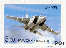 RUSSIA - 2005: shows The Mikoyan-Gurevich MiG-25, series OKB planes by A.I.Mikoyan, the aircraft designer. RUSSIA - CIRCA 2005: A stamp printed in Russia shows royalty free stock image
