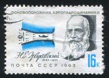 Zhukovski. RUSSIA - CIRCA 1963: stamp printed by Russia, shows N. E. Zhukovski, aerodynamics pioneer, and pressurized air tunnel, circa 1963 Stock Photography