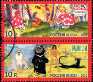 RUSSIA - CIRCA 2012: A stamp printed in Russia shows series Heroes of domestic cartoos: Vovka in Far Far Away Kingdom, Mowgli, ci. Rca 2012 vector illustration