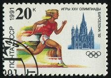 Postage stamp. RUSSIA - CIRCA 1991: stamp printed by Russia, shows 1992 Summer Olympic Games, Barcelona, Running, circa 1991 Royalty Free Stock Photo
