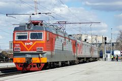 Russia, city of Magnitogorsk, - April, 25, 2015. Passenger train with electric locomotive arrives at the station stock images