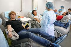 Russia, city of Magnitogorsk, - August, 19, 2015. Donating blood in a mobile blood collection station open to all citizens. Donation and charity royalty free stock photo