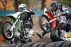 Russia, city of Magnitogorsk, - July, 10, 2011. Participants races motocross competition at an open city stadium royalty free stock photo