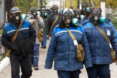 Russia, city of Magnitogorsk, - October, 7, 2016. The workers of the local enterprise. `Vodokanal` go to work during a training alert on chemical hazards stock photo