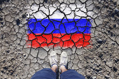 Russia cracked flag with man legs Royalty Free Stock Photography
