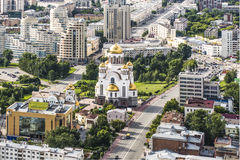 Russia . Ekaterinburg . Orthodox Church on a background of the city landscape. Russia . Ekaterinburg . Orthodox Church on a background of the city landscape Royalty Free Stock Photos