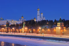 Russia. Ensemble of Moscow Kremlin at night. Russia. Ensemble of Moscow Kremlin view across a frozen Moskva river at a winter night. Close up view royalty free stock images