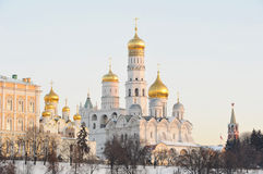 Russia. Ensemble of Moscow Kremlin in a winter. Russia. Ensemble of Moscow Kremlin. View on Kremlin cathedralas, wall and towers from Bolshoi Moskvoretsky bridge royalty free stock photography
