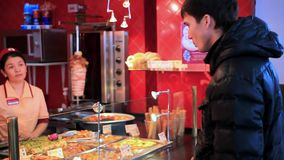 RUSSIA, 17 FEBRUARY, 2015, Young man ordering food. Young man ordering food from chef at restaurant stock video footage
