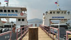 Russia - 07/11/2016: Ferry crossing to Olkhon Island: Transport ferry - transportation of people and cars, pier, coast, island, co stock photography