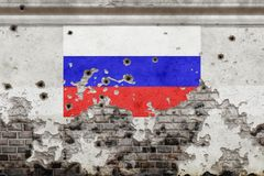 Russia flag and bullet holes. On wall stock image