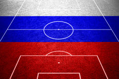Russia flag on empty soccer field Royalty Free Stock Photo