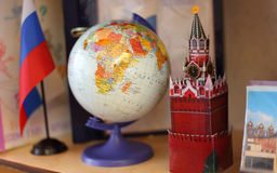 Russia flag, globe and Kremlin tower on shelf Royalty Free Stock Image