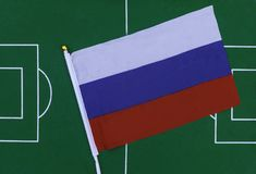 Russia flag on green field in stadium. Football background. Russia flag on green football stadium with copy space stock image
