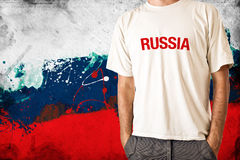 Russia flag. Man in white shirt with title RUSSIA, Russian flag in background Royalty Free Stock Photos