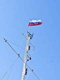 Russia flag on the mast. Develops a ship Stock Photo