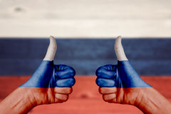 Russia flag painted on female hands thumbs up Royalty Free Stock Images