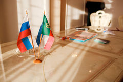Russia Flag and the Republic of Khakassia on table in a registry office. Royalty Free Stock Photography
