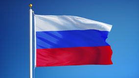 Russia flag in slow motion seamlessly looped with alpha. Russia flag waving in slow motion against blue sky, seamlessly looped, close up, isolated on alpha stock video footage