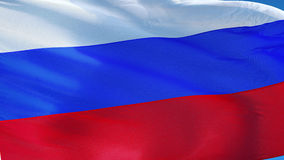 Russia flag in slow motion seamlessly looped with alpha. Russia flag waving in slow motion against blue sky, seamlessly looped, close up, isolated on alpha stock video