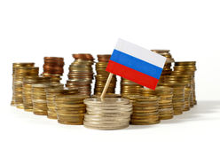 Russia flag with stack of money coins Stock Image